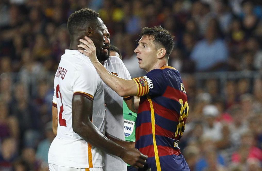 Lionel Messi et Mapou Yanga-Mbiwa.