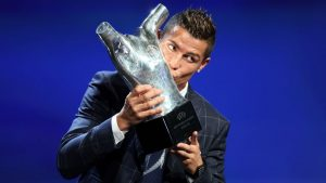 Real Madrid's Portuguese forward Cristiano Ronaldo kisses his trophy of Best Men's player in Europe at the end of the UEFA Champions League Group stage draw ceremony, on August 25, 2016 in Monaco. AFP PHOTO / VALERY HACHE / AFP / VALERY HACHE        (Photo credit should read VALERY HACHE/AFP/Getty Images)