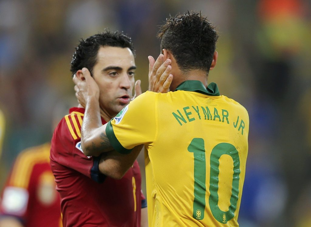 Brazil's Neymar is congratulated by Spain's Xavi after Brazil defeated Spain in the Confederations Cup final soccer match in Rio de Janeiro